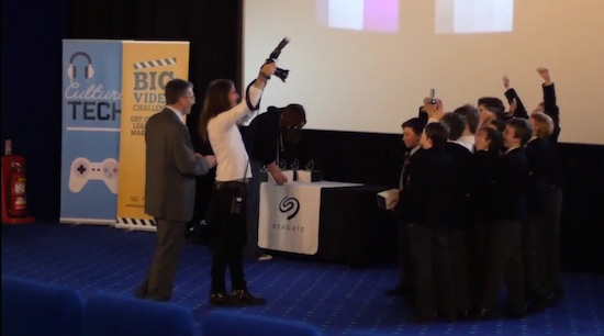 Codebreaker student team on stage with trophy