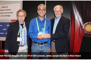 Brett Pemble, Seagate GM and VP of SSD products, center, accepts the Best in Show Award
