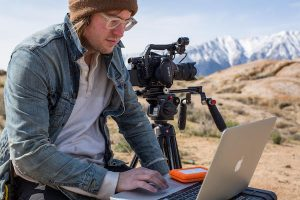 Filmmaker Chris Hershman editing in the field