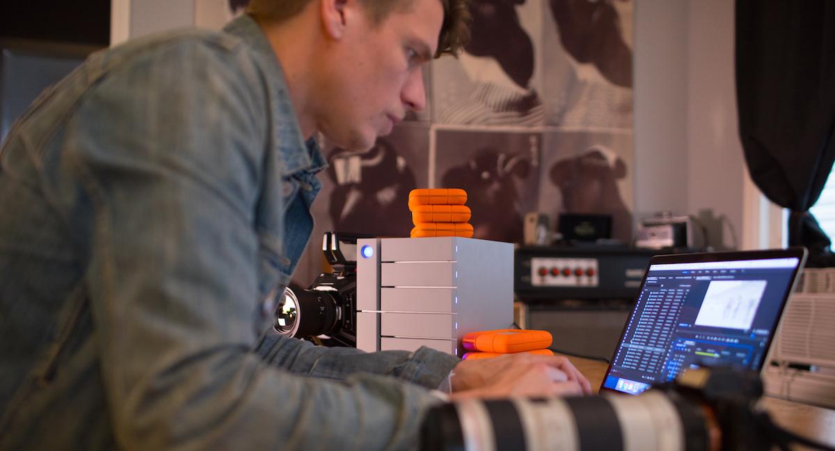Filmmaker Cory Popp at editing desk