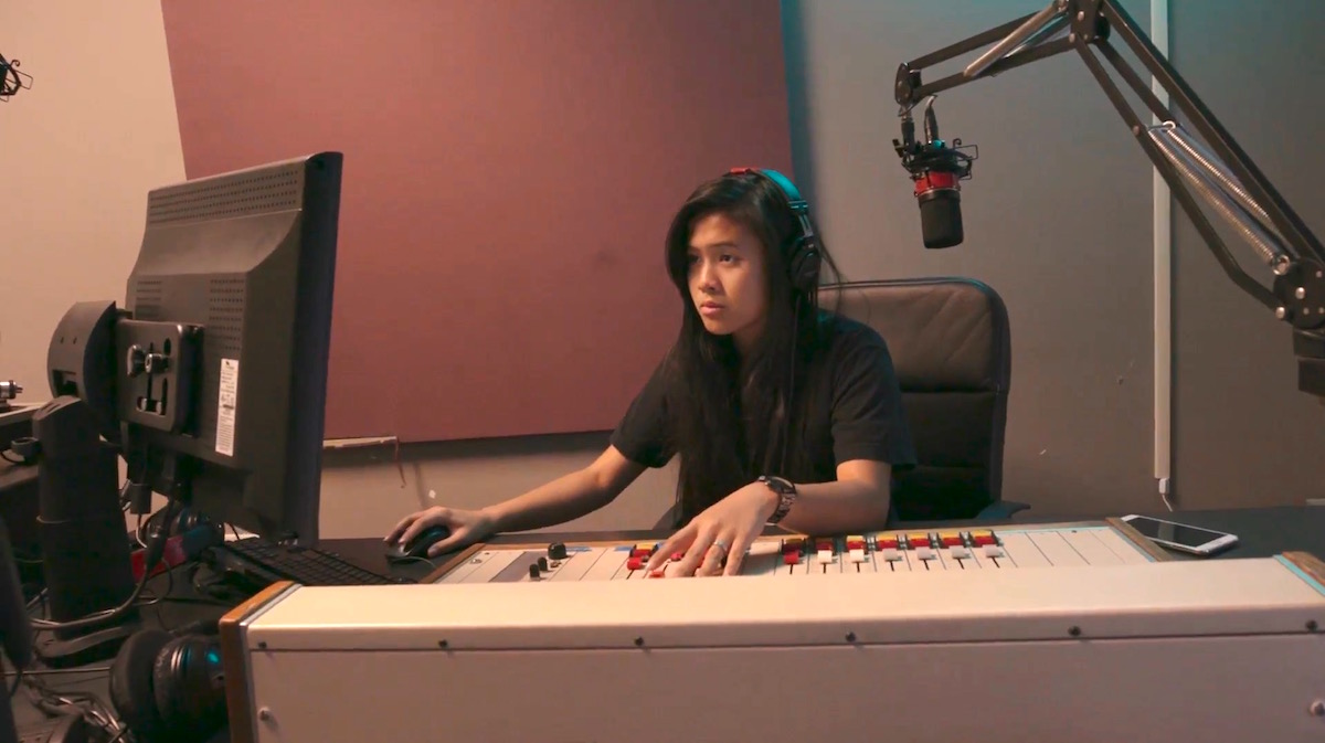 A Youth Radio student at the audio mix board