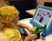 UC Davis researchers record a young child's brain activity using high-frequency EEG.