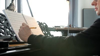 Thomas Berlin composing at his piano